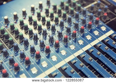 technology, electronics and equipment concept - control panel at recording studio or radio station
