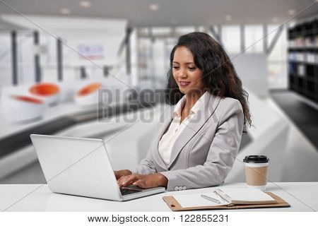 Young Malagasy business woman working on laptop in the office