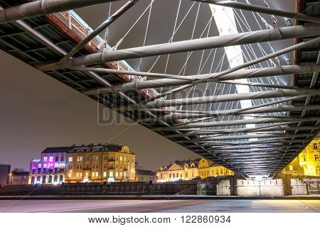 Bernatka Footbridge Over Vistula River In The Night In Krakow, Poland