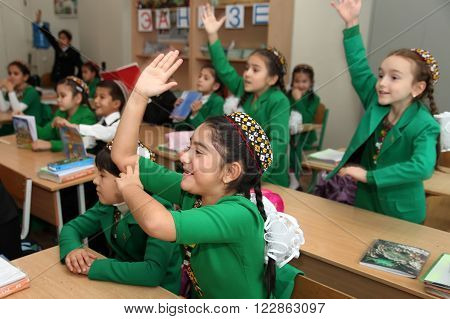 Ashgabad Turkmenistan - November 4 2014. Group of students in lesson in the classroom . November 4 2014. In schools of Turkmenistan annually trains about 900 thousand children.