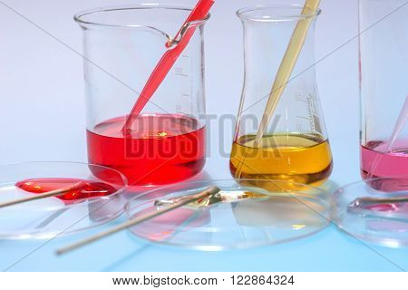 glass laboratory apparatus with color water on the table