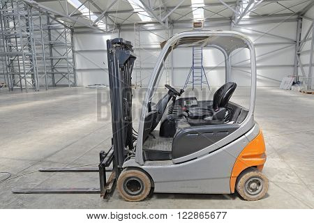 Electric Forklift Truck in Big Distribution Warehouse