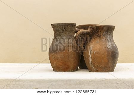 Old clay pot and a piece of wood