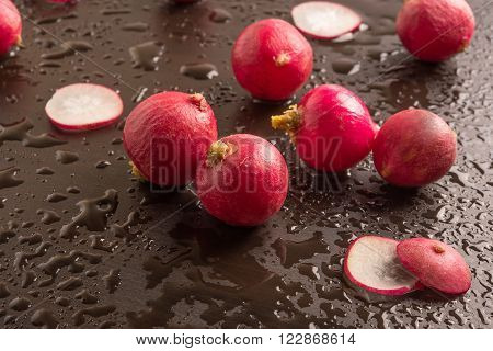 fresh radish in a wet black background
