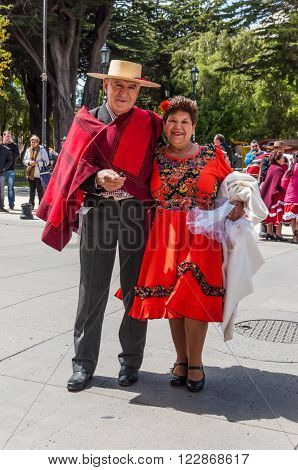 Punta Arenas Chile - December 9 2012: The chilean man and woman In chilean clothing during the meeting of the Folk dance club of Punta Arenas Chile.