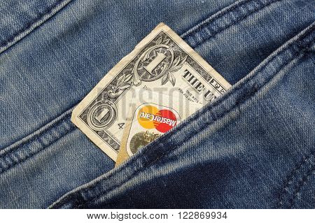 KHARKIV, UKRAINE - MARCH 16, 2016: American dollar, passport, credit cards Mastercard  sticking out of the pocket of jeans