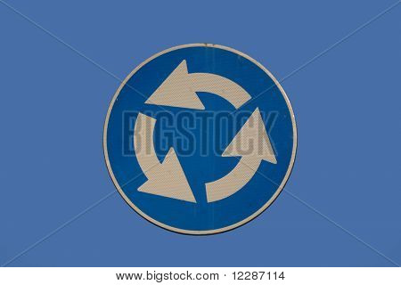 Roundabout sign isolated on blue