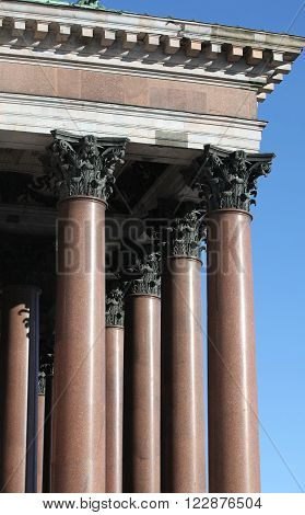 columns with portico on background blue sky