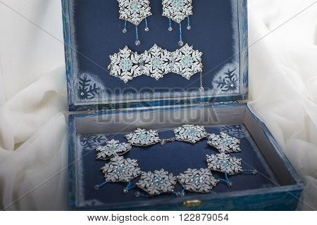 Hand made necklace closeup photo in box. Snowflake necklace ** Note: Shallow depth of field