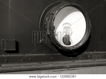Headlight of an old locomotive in the port of Magdeburg