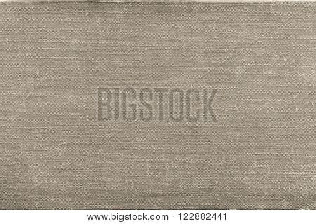 texture of rough old material from cotton or from a sackcloth for a textile background or for wallpaper of beige color with attritions