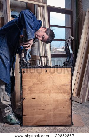 Carpenter Restoring Wooden Furniture
