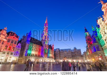 Brussels Belgium - May 13 2015: Tourists visiting famous Grand Place (Grote Markt) the central square of Brussels. The square is the most important tourist destination and most memorable landmark in Brussels.