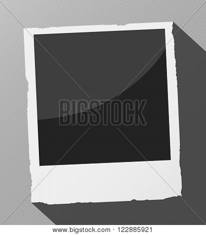 Black instant photo with frame and long shadow on a striped surface.