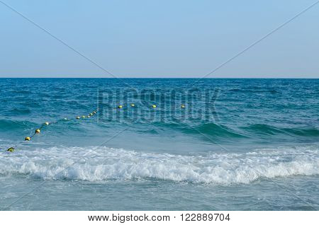 Beautiful sea summer or spring abstract background. Golden sand beach with blue ocean.