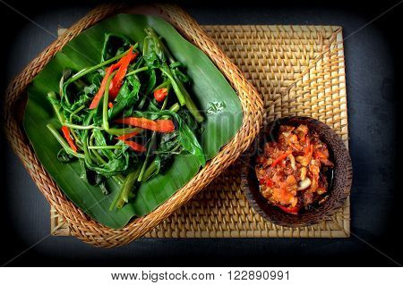 Kangkung Pelecing (Water spinach in tomato chili sambal) - vegetables dish in Bali, Indonesia