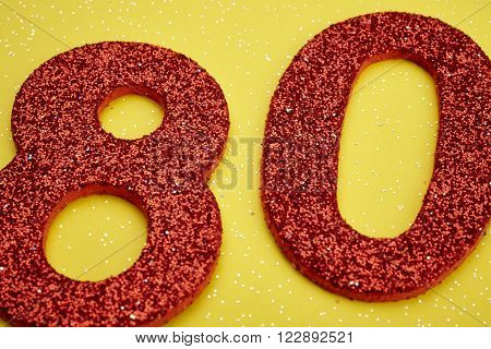 Number eighty red color over a yellow background. Anniversary. Horizontal