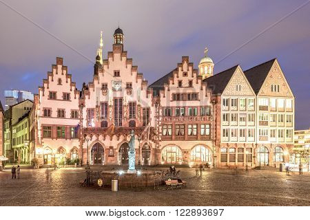 FRANKFURT GERMANY - MAR 15: Historic buildings at the Roemerberg in Frankfurt illuminated at night. March 15 2016 in Frankfurt Main Germany