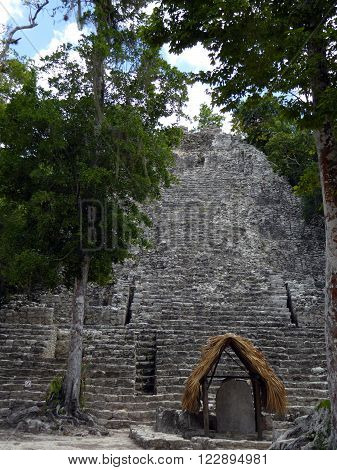 A largely unrenovated stone Mayan pyramid at the Coba archeological site of Mexico.