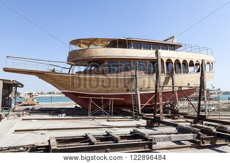 Traditional wooden dhow in a dockyard of Manama Kingdom of Bahrain Middle East