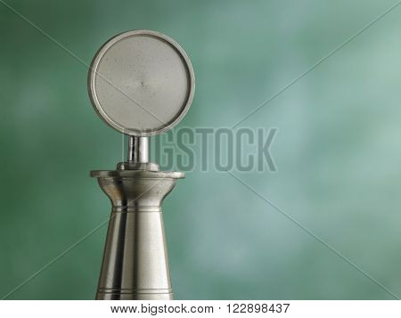 old pewter trophy in front of blackboard