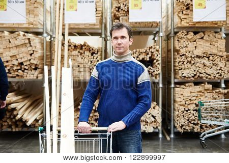 Man Shopping For Timber In Shop