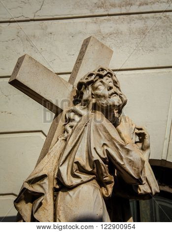Robed saint carrying a cross in Recoleta Cemetery