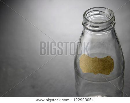 empty saving jar on the black slate labelled