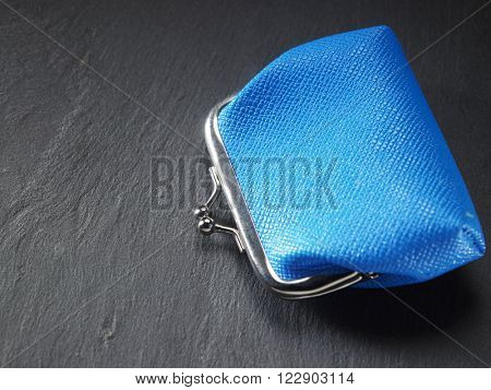 closed coin purse on the black slate