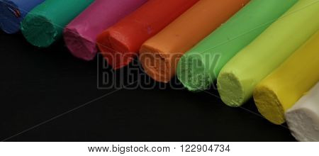 This is a plastic putty with wax gum for children playing