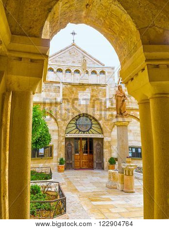 BETHLEHEM PALESTINE - FEBRUARY 18 2016: The view on the Church of the St. Catherine through the Franciscan courtyard on February 18 in Bethlehem.