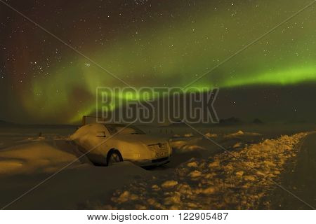 MODRUDALUR ICELAND March 3 2016 : Aurora Borealis in Iceland skies. Auroras are produced when the magnetosphere is disturbed by the solar win.