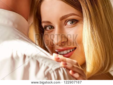 Sharing moments. Close up shot of young attractive woman standing close to man and holding his shoulder.