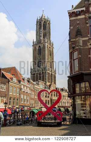 Utrecht, Netherlands - May 6: This is tower of the Dome Cathedral climbing between streets of the city May 6, 2013 in Utrecht, Netherlands.