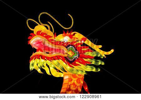 London United Kingdom - February 07 2016: Magical Lantern Festival at Chiswick House And Gardens. A dragon head lantern on a black background