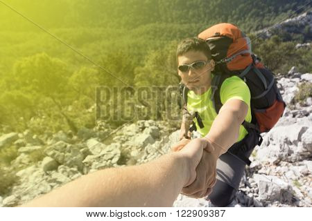 Help, support and help in a dangerous situation to hike in the mountains. ** Note: Shallow depth of field