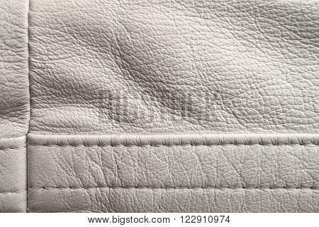 White leather stitching detail, close up shot