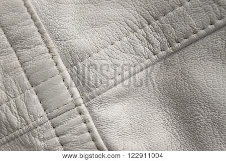 White leather close up. Diagonal stitch detail