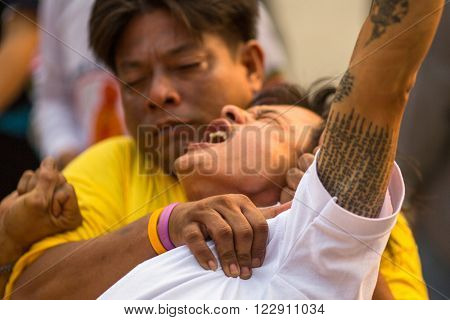 WAT BANG PHRA, THAILAND - MAR 19, 2016: Unknown participants Master Day Ceremony at able Khong Khuen - spirit possession during the Wai Kroo ritual at Bang Pra monastery, about 50 km west of Bangkok.
