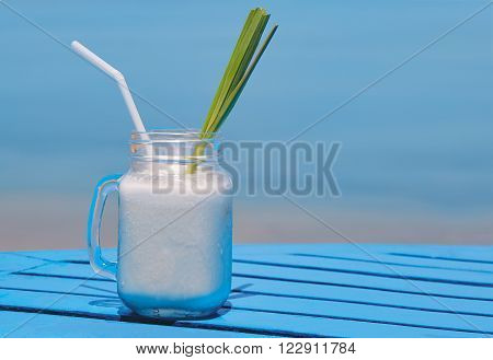 virgin pina colada on a sea background
