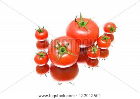 ripe tomatoes on a white background close-up with a mirror image. horizontal photo.