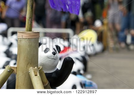 CHIANG MAITHAILAND March 19 2016 : Pandas World Tour by WWF exhibition of the 1600 paper mache pandas during a flash mob world tour made by French artist Paulo Grangeon at Tha Phae Gate Chiang Mai.