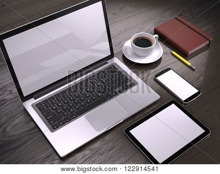 Workplace with Laptop, Tablet PC and smartphone with blank screens on table