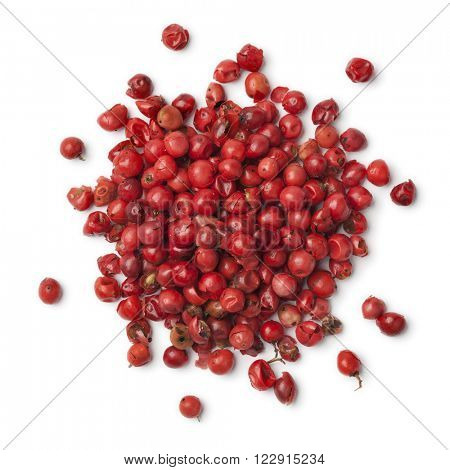 Heap of rose peppercorns on white background