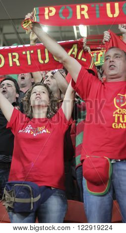 DONETSK UKRAINE - JUNE 27 2012: Unidentified Portugal soccer fans before UEFA EURO 2012 match in Donetsk on Donbass Arena