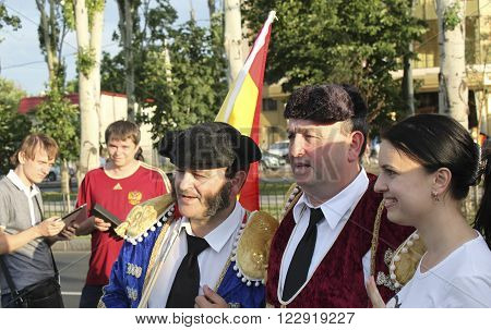 DONETSK, UKRAINE - JUNE 27, 2012: Unidentified Spanish soccer fans before UEFA EURO 2012 match in Donetsk near Donbass Arena