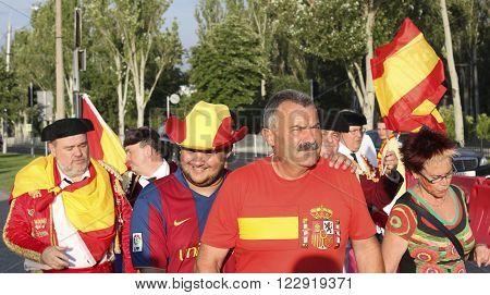 DONETSK UKRAINE - JUNE 27 2012: Unidentified Spanish soccer fans before UEFA EURO 2012 match in Donetsk near Donbass Arena