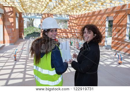 Female contractors in a building site of a house