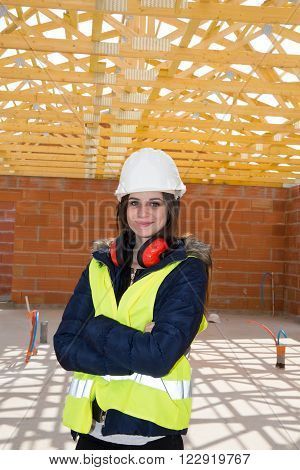 Young Woman Architect On The Building Site Of Construction Project