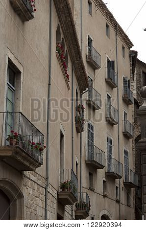 Balconies in old houses of small Spanish cities. Girona